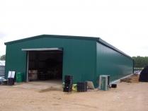 Nave almacén agrícola ECORAPID. Cubierta y fachadas en panel sándwich. Cuenca. 350 m2