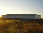 Nave prefabricada ECORAPID para exposición y almacén - Nave modular personalizada para comercio con cerramiento metálico.