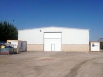 Almacén de maquinaria. 500 m2. Cerramiento en chapa simple. Burgos